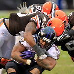 Baltimore Ravens running back Ray Rice is tackled by Cleveland Browns safety T.J. Ward (43), defensive tackle Billy Winn (90) and defensive end Frostee Rucker in the fourth quarter of an NFL …