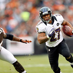 Baltimore Ravens running back Ray Rice runs past Cleveland Browns defensive end Juqua Parker in the first quarter of an NFL football game in Cleveland, Sunday, Nov. 4, 2012. (AP Photo/Rick O …