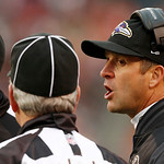 Baltimore Ravens head coach John Harbaugh, right, talks with line judge Jeff Bergman in the third quarter of an NFL football game against the Cleveland Browns in Cleveland, Sunday, Nov. 4, 2 …