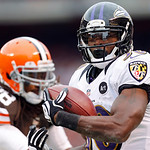 Baltimore Ravens running back Bernard Pierce scores on a 12-yard run against Cleveland Browns safety Usama Young (28) in the first quarter of an NFL football game in Cleveland, Sunday, Nov.  …
