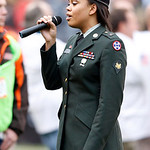 U.S. Army Reserve Spc. Chanel A. Curry sings the Star Spangled Banner before an NFL football game between the Cleveland Browns and the Baltimore Ravens in Cleveland, Sunday, Nov. 4, 2012. (A …