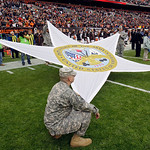 U.S. Army soldiers hold a star during the national anthem before an NFL football between the Cleveland Browns and the Baltimore Ravens game Sunday, Nov. 4, 2012, in Cleveland. (AP Photo/Tony …