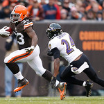 Cleveland Browns running back Trent Richardson (33) runs the ball as Baltimore Ravens defensive back Corey Graham (24) tries to make a tackle in the second half of an NFL football game in Cl …