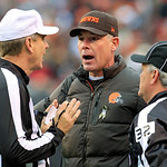 Cleveland Browns head coach Pat Shurmur, center, argues a call with referee Jeff Triplette, left, and line judge Jeff Bergman in the first quarter of an NFL football game against the Baltimo …