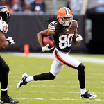 Cleveland Browns wide receiver Travis Benjamin (80) runs the ball against the Baltimore Ravens in an NFL football game Sunday, Nov. 4, 2012, in Cleveland. (AP Photo/Tony Dejak)
