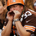 A Cleveland Browns fan yells during an NFL football game against the Cincinnati Bengals Sunday, Oct. 14, 2012, in Cleveland. (AP Photo/Tony Dejak)