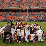 Cleveland Browns and Cincinnati Bengals players gather for prayer after the Browns beat the Bengals 34-24 in an NFL football game Sunday, Oct. 14, 2012, in Cleveland. (AP Photo/Mark Duncan)