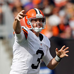 Cleveland Browns quarterback Brandon Weeden passes against the Cincinnati Bengals in the first quarter of an NFL football game on Sunday, Oct. 14, 2012, in Cleveland. (AP Photo/Scott R. Galv …