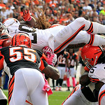 Cleveland Browns running back Montario Hardesty (20) leaps for a 1-yard touchdown against the Cincinnati Bengals in the fourth quarter of an NFL football game Sunday, Oct. 14, 2012, in Cleve …