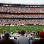 Fans watch the Cleveland Browns play the Cincinnati Bengals during an NFL football game Sunday, Oct. 14, 2012, in Cleveland. (AP Photo/Tony Dejak)
