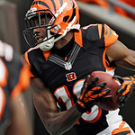 Cincinnati Bengals wide receiver A.J. Green (18) catches a 5-yard touchdown pass in the second quarter of an NFL football game against the Cleveland Browns Sunday, Oct. 14, 2012, in Clevelan …