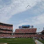 Military jets perform a flyover of Cleveland Browns Stadium before an NFL football game between the Browns and Cincinnati Bengals Sunday, Oct. 14, 2012, in Cleveland. (AP Photo/Mark Duncan)