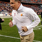 Cleveland Browns head coach Pat Shurmur jogs off the field after a 34-24 win over the Cincinnati Bengals in an NFL football game Sunday, Oct. 14, 2012, in Cleveland. The win, the Browns' fir …