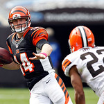 Cincinnati Bengals quarterback Andy Dalton (14) runs away from Cleveland Browns cornerback Buster Skrine (22) in the third quarter of an NFL football game Sunday, Oct. 14, 2012, in Cleveland …