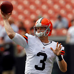 Cleveland Browns quarterback Brandon Weeden warms up before the Browns play the Cincinnati Bengals in an NFL football game Sunday, Oct. 14, 2012, in Cleveland. (AP Photo/Tony Dejak)