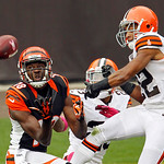 Cincinnati Bengals wide receiver A.J. Green, left, catches a pass against Cleveland Browns cornerbacks Joe Haden and Buster Skrine (22) in the second quarter of an NFL football game Sunday,  …