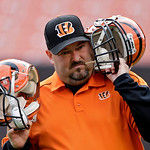 Cincinnati Bengals equipment man Trey Arrowsmith checks the audio in the quarterbacks helmets before an NFL football game against the Cleveland Browns Sunday, Oct. 14, 2012, in Cleveland. (A …