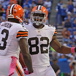 Cleveland Browns' Josh Gordon (13) and Benjamin Watson celebrate after a 33-yard touchdown reception by Gordon  during the second half of an NFL football game against the Indianapolis Colts  …