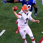 Indianapolis Colts' Dwight Freeney chases Cleveland Browns quarterback Brandon Weeden (3) as Weeden passes during the second half of an NFL football game, Sunday, Oct. 21, 2012, in Indianapo …