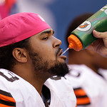 Cleveland Browns' John Hughes takes a drink of water while weating a pink hat for breast cancer awareness during the first half of an NFL football game against the Indianapolis Colts  Sunday …