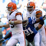 Cleveland Browns' Brandon Weeden runs against Indianapolis Colts' Lawrence Guy during the first half of an NFL football game Sunday, Oct. 21, 2012, in Indianapolis. (AP Photo/Michael Conroy)