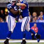 Indianapolis Colts' Mario Harvey (54) and Pat Angerer celebrate following a play during the first half of an NFL football game against the Cleveland Browns, Sunday, Oct. 21, 2012, in Indiana …
