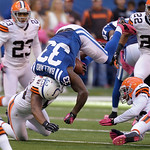 Indianapolis Colts' Vick Ballard (33) is tackled by Cleveland Browns' Craig Robertson during the second half of an NFL football game Sunday, Oct. 21, 2012, in Indianapolis. (AP Photo/Michael …
