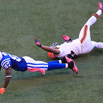 Indianapolis Colts' Reggie Wayne (87) drives after being tackled by Cleveland Browns' Sheldon Brown during the second half of an NFL football game Sunday, Oct. 21, 2012, in Indianapolis. (AP …
