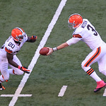 Cleveland Browns' Brandon Weeden hands off to Montario Hardesty during the second half of an NFL football game against the Indianapolis Colts Sunday, Oct. 21, 2012, in Indianapolis. (AP Phot …