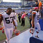 Cleveland Browns' Craig Robertson (53) and John Hughes leave the field after the Colts defeated the Brown, 17-13, in an NFL football game Sunday, Oct. 21, 2012, in Indianapolis. (AP Photo/Mi …