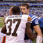 Indianapolis Colts' Andrew Luck (12) is congratulated by Cleveland Browns' Johnson Bademosi after the Colts defeated the Browns, 17-13, in an NFL football game Sunday, Oct. 21, 2012, in Indi …