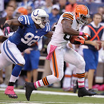 Cleveland Browns' Benjamin Watson is tackled by Indianapolis Colts' Jerry Hughes during the second half of an NFL football game Sunday, Oct. 21, 2012, in Indianapolis. (AP Photo/Michael Conr …