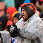 A Cleveland Browns fan cheers in an NFL football game against the San Diego Chargers Sunday, Oct. 28, 2012, in Cleveland. (AP Photo/Tony Dejak)