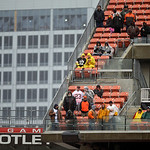 Fans watch an NFL football game between the Cleveland Browns and the San Diego Chargers in a steady rain Sunday, Oct. 28, 2012, in Cleveland. (AP Photo/Mark Duncan)