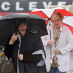 Two fans make their way through wind and rain to Cleveland Browns Stadium for an NFL football game between the Browns and San Diego Chargers Sunday, Oct. 28, 2012, in Cleveland. (AP Photo/Ph …
