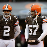 Cleveland Browns punter Reggie Hodges (2) talks with long snapper Christian Yount (57) before an NFL football game against the San Diego Chargers Sunday, Oct. 28, 2012, in Cleveland. (AP Pho …