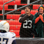 Two Cleveland Browns fans gesture toward San Diego Chargers center Rex Hadnot before an NFL football game Sunday, Oct. 28, 2012, in Cleveland. (AP Photo/Tony Dejak)