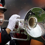 Rain drops bead up on the instrument of an Ohio State University band member during the national anthem before an NFL football game between the Cleveland Browns and the San Diego Chargers Su …
