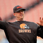 Cleveland Browns quarterback Brandon Weeden warms up in the rain before an NFL football game against the San Diego Chargers Sunday, Oct. 28, 2012, in Cleveland. (AP Photo/Tony Dejak)