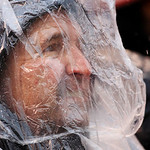 A fan wards off the rain during the third quarter of an NFL football game between the Cleveland Browns and San Diego Chargers Sunday, Oct. 28, 2012, in Cleveland. (AP Photo/Tony Dejak)
