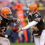 Cleveland Browns quarterback Brandon Weeden (3) hands off to running back Trent Richardson in the third quarter of an NFL football game against the San Diego Chargers Sunday, Oct. 28, 2012, …
