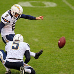 San Diego Chargers place kicker Nick Novak (9) kicjks a 43-yard field goal out of the hold by punter Mike Scifres (5) late in the second quarter of an NFL football game against the Cleveland &#8230;