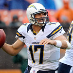 As rain falls, San Diego Chargers quarterback Philip Rivers rolls out to pass in the third quarter of an NFL football game against the Cleveland Browns, Sunday, Oct. 28, 2012, in Cleveland.  …