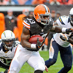 Cleveland Browns running back Trent Richardson (33) breaks a tackle by San Diego Chargers safety Eric Weddle (32) on a 26-yard touchdown run in the first quarter of an NFL football game in t …