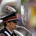 An Ohio State University sousaphone player takes the field for the national anthem before an NFL football game between the Cleveland Browns and the San Diego Chargers Sunday, Oct. 28, 2012, …