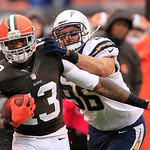 Cleveland Browns wide receiver Josh Gordon (13) is tackled by San Diego Chargers linebacker Jarret Johnson after a pass reception for a first down in the third quarter of an NFL football gam …