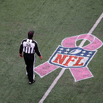 Head linesman Tony Veteri (36) is shown on the field near a Breast Cancer Awareness logo during the first half of an NFL football game between the New York Giants and the Cleveland Browns, S …