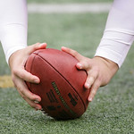 An NFL football is handled during the first half of an NFL football game Sunday, Oct. 7, 2012, in East Rutherford, N.J. (AP Photo/Peter Morgan)