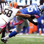 New York Giants tight end Martellus Bennett (85) breaks a tackle by Cleveland Browns linebacker Marcus Benard (58) during the first half of an NFL football game Sunday, Oct. 7, 2012, in East …