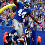 New York Giants running back Ahmad Bradshaw (44) celebrates after scoring a touchdown during the first half of an NFL football game against the Cleveland Browns, Sunday, Oct. 7, 2012, in Eas …